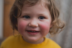 Girl (3) in yellow jumper smiling Royalty Free Stock Photos