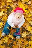 Girl in yellow leaves Royalty Free Stock Images