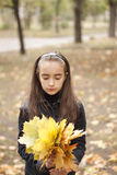 Girl and yellow leaves. At autumn Royalty Free Stock Photos
