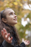Girl and yellow leaves. At autumn Stock Images
