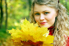 Girl and yellow leaves Royalty Free Stock Photo