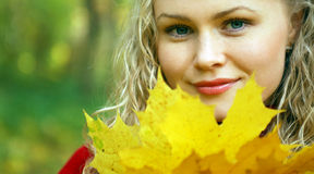 Girl and yellow leaves Stock Photography