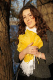 Girl with yellow leaves. Girl holding a large yellow leaves Royalty Free Stock Photography