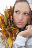 Girl and yellow leaves. The girl with dry leaves from trees royalty free stock photography