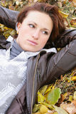 Girl and yellow leaves. The girl with dry leaves from trees stock images