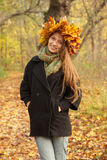 Girl in yellow leaves crown Stock Image