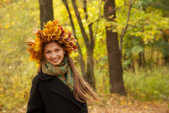 Girl in yellow leaves crown Royalty Free Stock Image