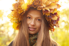 Girl in yellow leaves crown Stock Images