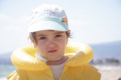Girl in yellow life jacket Stock Images