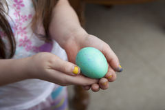Girl With Yellow Nails Holding Blue Easter Egg Royalty Free Stock Photo