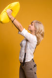 Girl with a yellow pillow Royalty Free Stock Images