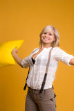 Girl with a yellow pillow Stock Photo