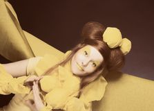 Girl in yellow. Stock Images