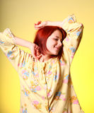 Girl in yellow pyjamas Stock Photography