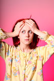 Girl in yellow pyjamas with headache Royalty Free Stock Photography