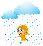 Girl with yellow raincoat running in the rain Royalty Free Stock Images