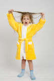 Girl in a yellow robe lifted wet hair Stock Photos