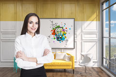 Girl in a yellow room with a light bulb poster Stock Photography