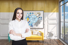 Girl in a yellow room with a target poster. Portrait of a black haired businesswoman standing in a yellow room with a target poster Stock Photo
