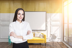 Girl in a yellow room with a whiteboard Royalty Free Stock Image