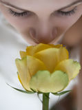 Girl and yellow rose Royalty Free Stock Images