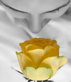 Girl and yellow rose Stock Images