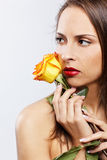 Girl with yellow rose Royalty Free Stock Photography