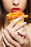 Girl with yellow rose Royalty Free Stock Image