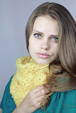 Girl in a yellow scarf Royalty Free Stock Photos