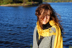 Girl with a yellow scarf. By the lake in nice early autumn day Royalty Free Stock Photography