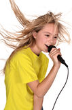 Girl in the yellow shirt singing Stock Images
