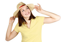 Girl in yellow shirt and straw hat smiling Stock Photography