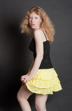 Girl in a yellow skirt Stock Photos