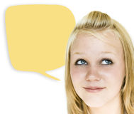 Girl with Yellow Speech Bubble. Girl looking upward with speech bubble ready for your copy to her right royalty free stock photo