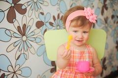 Girl with Yellow Spoon Stock Photos