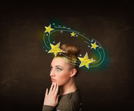 Girl with yellow stars circleing around her head illustration Stock Images