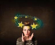 Girl with yellow stars circleing around her head illustration Stock Photos