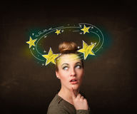 Girl with yellow stars circleing around her head illustration Stock Photo