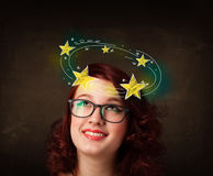Girl with yellow stars circleing around her head illustration Royalty Free Stock Photography