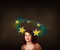 Girl with yellow stars circleing around her head Stock Images