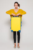 Girl with a yellow suitcase Stock Image