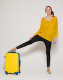 Girl with a yellow suitcase Stock Photography
