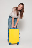 Girl with a yellow suitcase Royalty Free Stock Photo