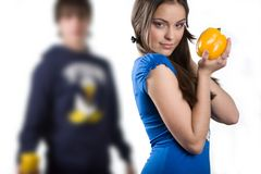 Girl with yellow sweet pepper Stock Photos