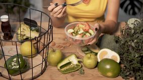 Girl Eats Vegetable Salad stock footage