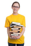 Girl in yellow T-shirt holding a stack of books Royalty Free Stock Photography