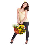 Girl in yellow t-shirt with wild spring flower. Stock Photography
