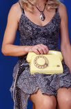 Girl with yellow telephone set Royalty Free Stock Photography