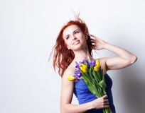 Girl with yellow tulip Stock Image