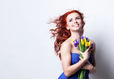 Girl with yellow tulip Royalty Free Stock Images